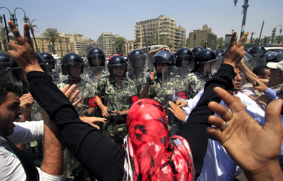 Demonstrators are prevented by military police from reaching Tahrir Square, to hold a protest in memory of protester Mohammed Mohsen, who died on Wednesday from wounds received during clashes in the Abbasiyah area of Cairo on July 23, in downtown Cairo, Egypt Friday, Aug. 5, 2011. (AP Photo/Khalil Hamra)