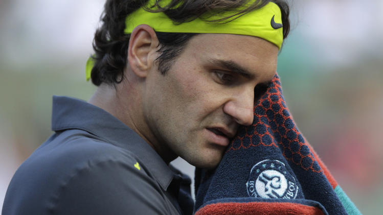 Roger Federer of Switzerland wipes his forehead after his third round match against Nicolas Mahut of France at the French Open tennis tournament in Roland Garros stadium in Paris, Friday June 1, 2012. Federer won in four sets 6-3, 4-6, 6-2, 7-5. (AP Photo/Michel Spingler)