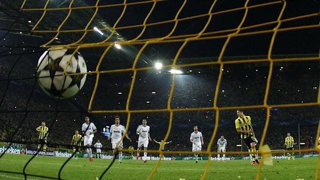 Borussia Dortmund's Robert Lewandowski (C) scores a penalty goal against Real Madrid during their Champions League semi-final first leg (Reuters)