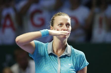 Kvitova of the Czech Republic blows kisses to the audience after defeating Sharapova of Russia during their WTA Finals singles tennis match at the Singapore Indoor Stadium