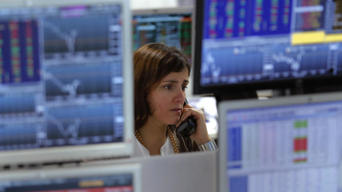 A broker talks on the phone while working in a trading room of a Portuguese bank in Lisbon, Wednesday, Jan. 23, 2013. Portugal was selling its debt on financial markets for the first time since it needed a bailout, holding an auction of five-year bonds. Portugal required a euro 78 billion ($102 billion) lifeline in May 2011 to avert bankruptcy as lenders turned their back on the debt-heavy country. (AP Photo/Francisco Seco)