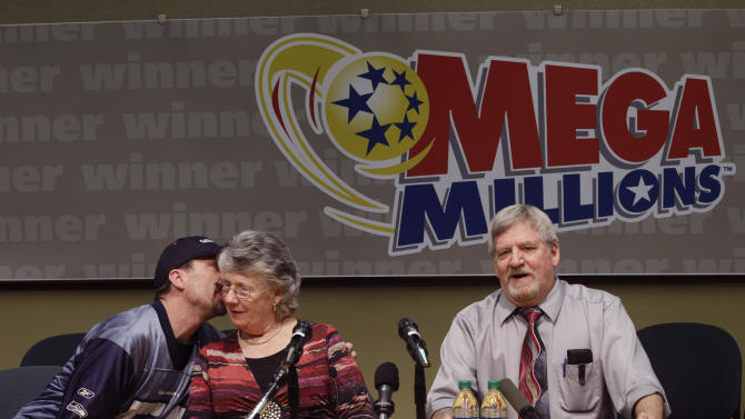 Jason McCullar, left, talks to his mother Carolyn McCullar at left, as his father, Jim McCullar, right, the winner of a   Mega Millions lottery jackpot, talks to reporters, Thursday, Jan. 6, 2011, in Olympia, Wash. The McCullars will split the $380 million prize with another person who has not yet come forward, who purchased a ticket in Idaho. (AP Photo/Ted S. Warren)