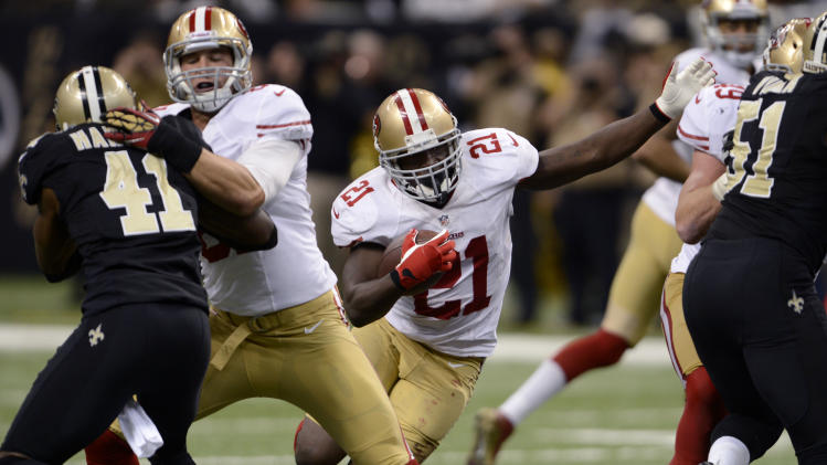 San Francisco 49ers running back Frank Gore (21) carries the ball as New Orleans Saints strong safety Roman Harper (41) is blocked in the second half of an NFL football game in New Orleans, Sunday, Nov. 25, 2012. The 49ers won 31-21. (AP Photo/Bill Feig)
