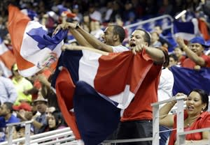 Dominican Republic fans cheer after Hanley Ramirez hit a solo home run against the United States during the second inning of a second-round game of the World Baseball Classic in Miami, Thursday, March 14, 2013. (AP Photo/Alan Diaz)