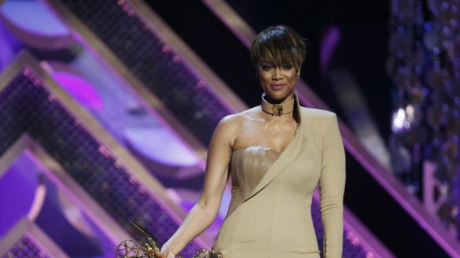 Show host Tyra Banks holds an award on stage at the 42nd Annual Daytime Emmy Awards in Burbank