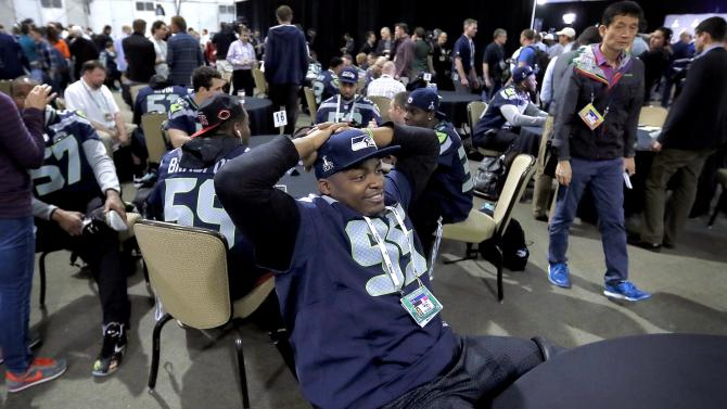 Seattle Seahawks' Demarcus Dobbs relaxes at a news conference for NFL Super Bowl XLIX football game, Wednesday, Jan. 28, 2015, in Phoenix. The Seahawks play the New England Patriots in Super Bowl XLIX on Sunday, Feb. 1, 2015