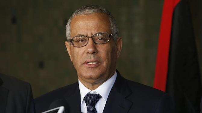 FILE - In this Tuesday, Oct. 8, 2013 file photo, Libyan's Prime Minister Ali Zidan speaks to the media during a press conference in Rabat, Morocco. Zidan was snatched by gunmen before dawn Thursday from a Tripoli hotel where he resides, the government said. The abduction appeared to be in retaliation for the U.S. special forces' raid over the weekend that seized a Libyan al-Qaida suspect from the streets of the capital. (AP Photo/Abdeljalil Bounhar)