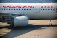 Hong Kong Airlines played down the impact on its business of an unprecedented aviation authority ban on expanding further until it meets all safety requirements for operating a larger fleet