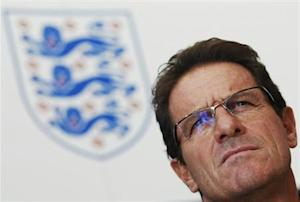 England soccer manager Fabio Capello watches players during a training session at London Colney