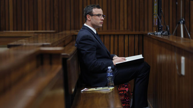"""Oscar Pistorius sits in the courtroom during day 37 of his trial in Pretoria, South Africa, Thursday, July 3, 2014. Pistorius is a """"paradox"""" whose past triumphs as a sprinter crossing the finish line with raised arms contrasted sharply with the daily, severe limitations that he endured because of his disability, a physician testified Thursday at the runner's murder trial. (AP Photo/Jerome Delay, Pool)"""
