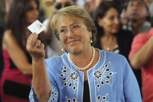 Chilean presidential candidate Michelle Bachelet shows her vote during the presidential election in Santiago