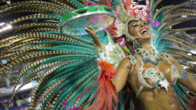 ADDS IDENTIFICATION AND NATIONALITY OF PERFORMER.-  Maria Caren Paz,  from Argentina,  from the Mangueira samba school parades during carnival celebrations at the Sambadrome in Rio de Janeiro, Brazil, Monday, Feb. 11, 2013. (AP Photo/Felipe Dana)