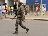File photo shows a Guinea-Bissau military soldier patrolling a street on April 13, a day after a military coup derailed presidential elections. Guinea-Bissau's armed forces vowed on May 23 to return to their barracks after transitional authorities formed a new government that includes an army officer who participated in the country's April 12 coup