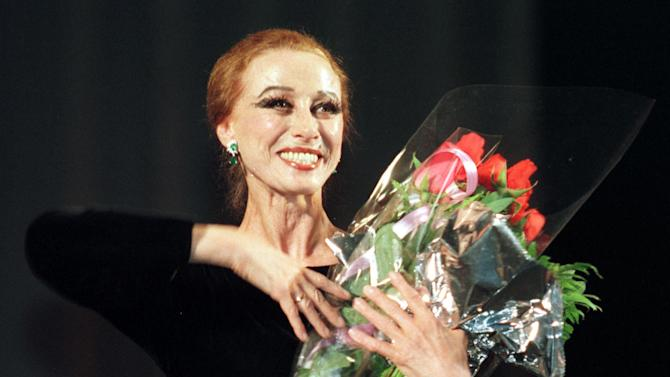 FILE - In this photo made on May 22, 1998, the legend of the world ballet, 73-aged Maya Plisetskaya receives ovations from spectators after a ballet performance in the Zhovtnevy Palace in Kiev, Ukraine.   Maya Plisetskaya, 89, widely regarded as one of the greatest ballerinas of her time, died Saturday, May 2, 2015, from a heart attack in Germany, according to an announcement by famous ballet dancer Mikhail Baryshnikov, and Russian Prime Minister Dmitry Medvedev offered condolences on the death. (AP Photo/Efrem Lukatsky)