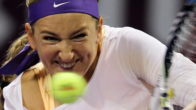 Belarus' Victoria Azarenka returns the ball to Serena Williams of the U.S, in the final match of Qatar WTA Ladies Open tennis tournament in Doha, Qatar, Sunday, Feb. 17, 2013. (AP Photo/Osama Faisal)