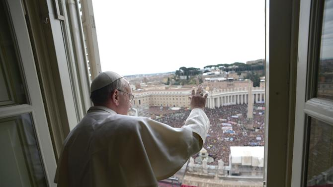 """In this photo provided by the Vatican paper L'Osservatore Romano, Pope Francis delivers his Angelus prayer from the window of his studio overlooking St. Peter's Square, at the Vatican, Sunday, March 17, 2013. Breaking with tradition, Pope Francis delivered off-the-cuff remarks about God's power to forgive instead of reading from a written speech for the first Sunday window appearance of his papacy. He also spoke only in Italian, beginning with """"buon giorno"""" (Good day) and ending with """"buon pranzo"""" (Have a good lunch), instead of greeting the faithful in several languages as his last few predecessors had done. (AP Photo/L'Osservatore Romano)"""