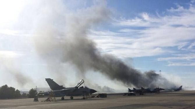 Smoke rises after a Greek F-16 fighter plane crashed during NATO training at the Albacete air base