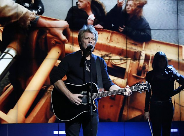 "FILE - In this Nov. 2, 2012, photo provided by NBC, Jon Bon Jovi performs in New York, during ""Hurricane Sandy: Coming Together,"" a concert hosted by NBC to raise money for victims of Superstorm Sandy. Bon Jovi and Bruce Springsteen Springsteen are among the New Jersey natives joining a special fund created in the wake of Superstorm Sandy. The musicians will serve on the advisory board of the Hurricane Sandy New Jersey Relief Fund. The nonprofit was created by state first lady Mary Pat Christie to aid in the long-term recovery effort following the storm. The board has raised more than $16 million, so far. (AP Photo/NBC, Heidi Gutman, file)"