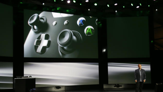 Marc Whitten, Microsoft Corp.'s chief production officer of interactive entertainment, talks about the controller of the next-generation Xbox One entertainment and gaming console system, Tuesday, May 21, 2013, at an event in Redmond, Wash. (AP Photo/Ted S. Warren)