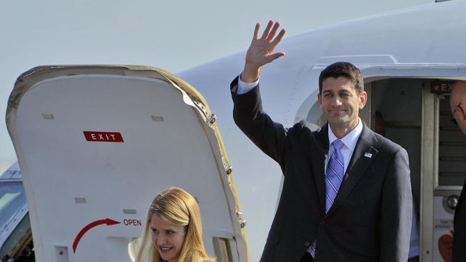 Republican vice presidential candidate Paul Ryan and his wife Janna arrive at Huntsville International Airport to attend a fund raising event in Huntsville, Ala Friday morning Oct. 26, 2012. (AP Photo/The Huntsville Times,  Bob Gathany)