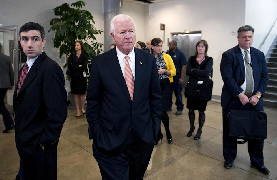 Senate Intelligence Committee Vice Chairman Sen. Saxby Chambliss, R-Ga. leaves a the committee's closed-door hearing on Capitol Hill in Washington, Friday, Nov. 16, 2012, where former CIA Director David Petraeus testified on the Sept. 11, 2012 attack in Libya. (AP Photo/Cliff Owen)
