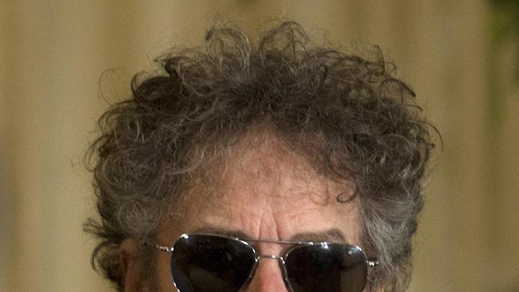 FILE - Bob Dylan arrives for a ceremony to receive the Presidential Medal of Freedom in the East Room of the White House, in this May 29, 2012 file photo taken in Washington. Dylan couldn't be there to be inducted Wednesday May 15, 2013 into the American Academy of Arts and Letters, but his presence was felt in both letter and spirit. (AP Photo/Carolyn Kaster, File)