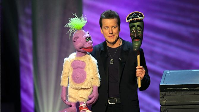 """In this undated image released by Levity Productions, comedian Jeff Dunham performs with his ventriloquist dolls, Peanut, left, Jose Jalapeno during the taping of his comedy special """"Controlled Chaos,"""" in Richmond, Va. The special will air Sept. 25, at 9 p.m. EST on Comedy Central. (AP  Photo/Levity Productions, Tom Whitmore)"""