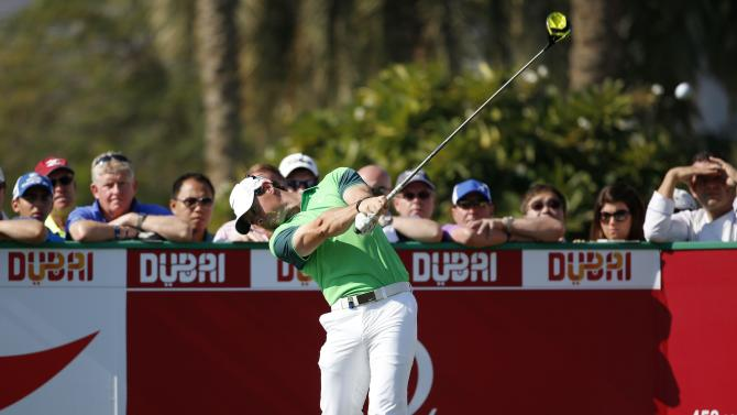 McIlroy of Northern Ireland tees off on the first hole during the Dubai Desert Classic