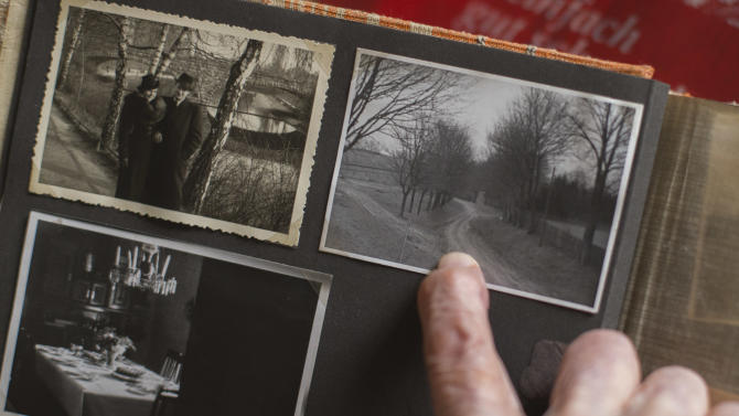 "Margot Woelk, one of the food testers of Adolf Hitler, shows an old photo album and points to a picture taken prior to the WWII and showing the way to the later built Fuehrer Headquarters ""Wolf's Lair"", during an interview with The Associated Press in Berlin, Thursday, April 25, 2013. Margot Woelk was one of 15 young women who sampled Hitler's food to make sure it wasn't poisoned before it was served to the Nazi leader in his ""Wolf's Lair,"" the heavily guarded command center in what is now Poland, where he spent much of his time in the final years of World War II. Margot Woelk kept her secret hidden from the world, even from her husband then, a few months after her 95th birthday, she revealed the truth about her wartime role. (AP Photo/Markus Schreiber)"