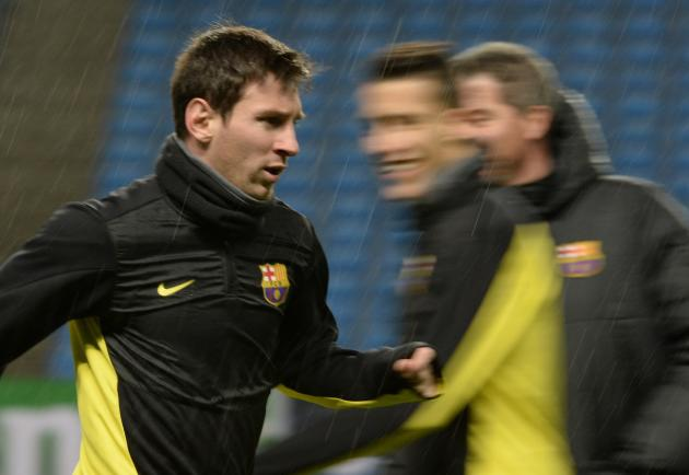 Barcelona's Messi runs during a training session at the Etihad Stadium in Manchester