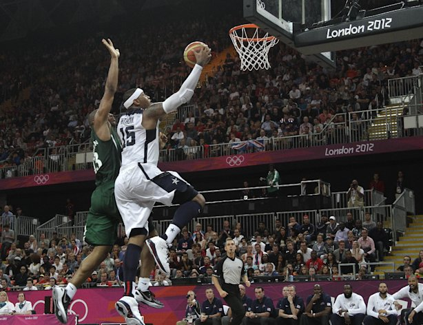 USA's Carmelo Anthony drives to the basket past Nigeria's Derrick Obasohan during a men's basketball game at the 2012 Summer Olympics, Friday, Aug. 3, 2012, in London. Anthony had 37 points in USA's 156-73 win.(AP Photo/Charles Krupa)