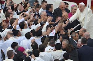 Pope Francis greets the crowd after a ceremony at the …