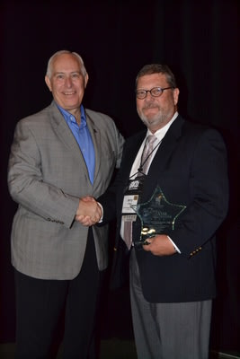 S. Joe DeHaven (left), President & CEO of the Indiana Bankers Association, presents the Five Star Member Award to Jerry Clapp (right), Member of First Savings Bank's Board of Directors.