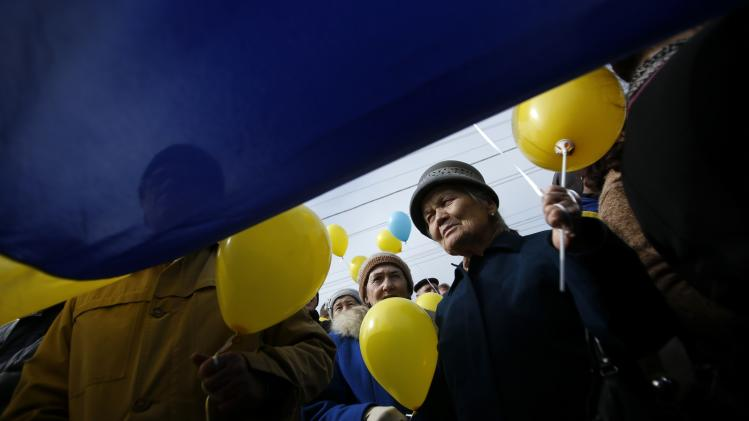 Pro-Ukrainian supporters take part in a rally in Simferopol