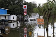 Floodwaters from Hurricane Isaac inundate structures in Scaresdale , La., Sunday, Sept. 2, 2012. More than 200,000 people across Louisiana still didn&#39;t have any power five days after Hurricane Isaac ravaged the state. Thousands of evacuees remained at shelters or bunked with friends or relatives. (AP Photo/Gerald Herbert)