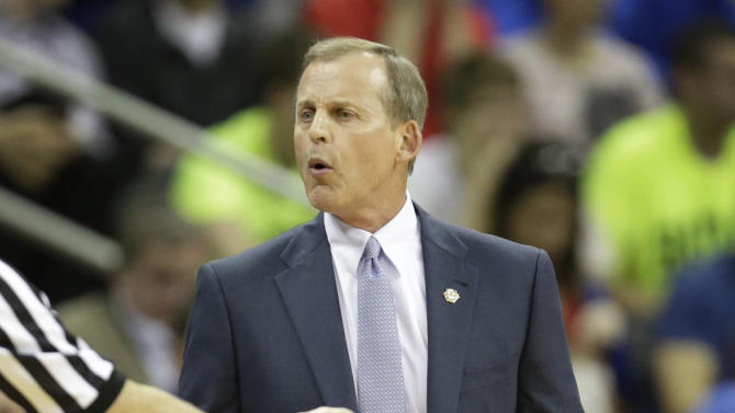 Texas head coach Rick Barnes talks with a referee during the first half of an NCAA college basketball game against Kansas State in the Big 12 tournament on Thursday, March 14, 2013, in Kansas City, Mo. (AP Photo/Orlin Wagner)