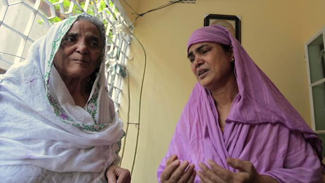 Grandmother, left, and aunt of Bangladeshi Quazi Mohammad Rezwanul Ahsan Nafis weep in his home in the Jatrabari neighborhood in north Dhaka, Bangladesh, Thursday, Oct. 18, 2012. The FBI arrested 21-year-old Nafis on Wednesday after he tried to detonate a fake 1,000-pound (454-kilogram) car bomb, according to a criminal complaint. His family said Thursday that Nafis was incapable of such actions. (AP Photo/A.M. Ahad)