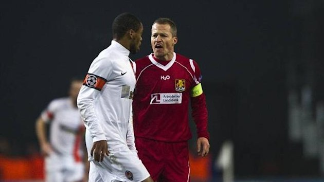 Nicolai Stockholm of FC Nordsjaelland berates Shakhtar Donetsk striker Luiz Adriano during their Champions League match on November 20 2012