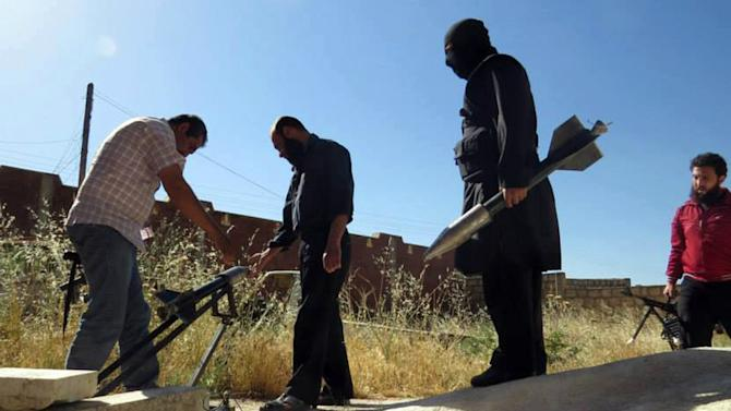 This citizen journalism image provided by Edlib News Network, ENN, which has been authenticated based on its contents and other AP reporting, shows Syrian rebels preparing to fire locally made rockets, in Idlib province, northern Syria, Tuesday, June 4, 2013. The Syrian government has denied it is facing a popular uprising since the revolt against Assad's rule erupted in March 2011, saying that the army is fighting foreign-backed terrorists who want to destroy the country.(AP Photo/Edlib News Network ENN)