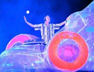 British DJ and musician Fatboy Slim performs during the closing ceremony of the 2012 London Olympic Games at the Olympic stadium in London on August 12, 2012