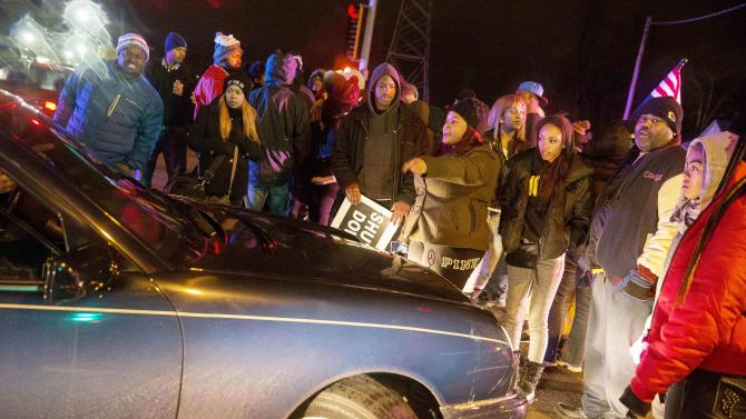 Protesters block an intersection, after a man was fatally shot by a policeman in Berkeley, Missouri