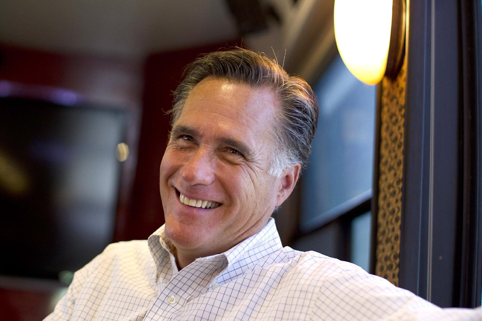 In this June 8, 2012, photo, Republican presidential candidate, former Massachusetts Gov. Mitt Romney smiles has he talks with his staff while riding on his bus after a campaign stop in Council Bluffs, Iowa. Republicans riding high from a string of breaks in their favor are increasingly optimistic about Romney's chances to claim the White House in November, even among conservatives who had qualms about making him the party's nominee. The bullish take is reflected in interviews with party strategists and activists, including people who supported Romney rivals during the primary season. Mood matters because it can fuel fundraising and volunteer hustle. But some of those GOP players stress that Romney has little room for error if he expects to topple an incumbent president.