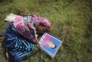 Nasima mourns on the grave of her daughter Akhi after her body was identified at a mass grave yard, where all the unidentified victims of Rana Plaza were buried, in Dhaka in this November 7, 2013 file photo.REUTERS/Andrew Biraj/Files