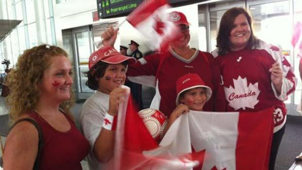 People gather at Toronto Pearson International airport to welcome home Canada's Olympians.
