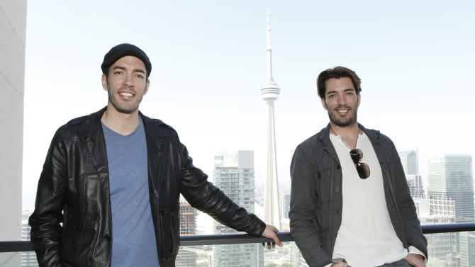 IMAGE DISTRIBUTED FOR BASK IT STYLE - Jonathan Scott and Drew Scott attend the Bask It Style media day on Wednesday Sept. 5, 2012, in Toronto, Canada. (Photo by Todd Williamson/Invision for Bask-It-Style/AP Images)