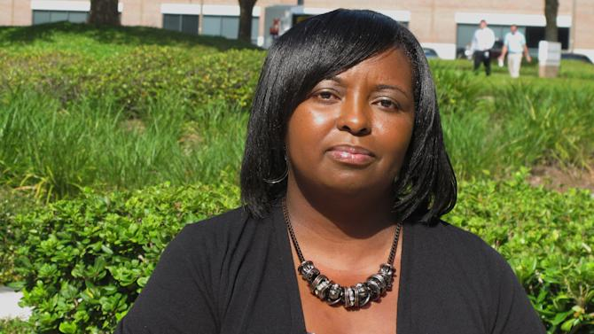 In this July 11, 2013 photo, former Sopchoppy City Commissioner Anginita Rosier poses for a photo in Tallahassee, Fla. State authorities are investigating her complaint that Sopchoppy city workers suppressed the black vote. Sopchoppy, Fla., a small Florida Panhandle town best known for its annual Worm Grunting Festival, is now the subject of a state investigation into allegations the white city clerk tried to suppress the black vote in an election in which the black mayor lost by one vote and Rosier was also ousted. (AP Photo/Brendan Farrington)