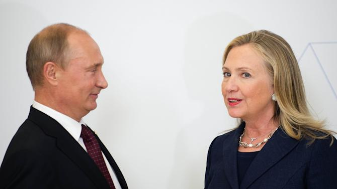In this Sept. 8, 2012 photo, U.S. Secretary of State Hillary Rodham Clinton, right, talks with Russian President Vladimir Putin during the arrival ceremony for the Asia-Pacific Economic Cooperation (APEC) Summit in Vladivostok, Russia. (AP Photo/Jim Watson, Pool)