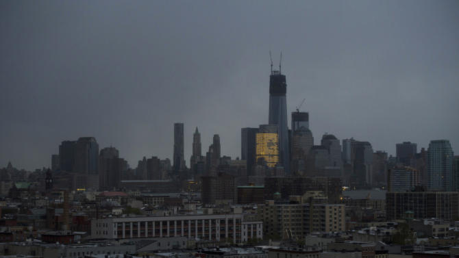One World Trade Center and large portions of lower Manhattan and Hoboken, N.J., are seen without power from Jersey City, N.J., Tuesday, Oct. 30, 2012, the morning after a powerful storm that started out as Hurricane Sandy made landfall on the East Coast. New York City awakened Tuesday to a flooded subway system, shuttered financial markets and hundreds of thousands of people without power a day after a wall of seawater and high winds slammed into the city, destroying buildings and flooding tunnels. (AP Photo/Charles Sykes)