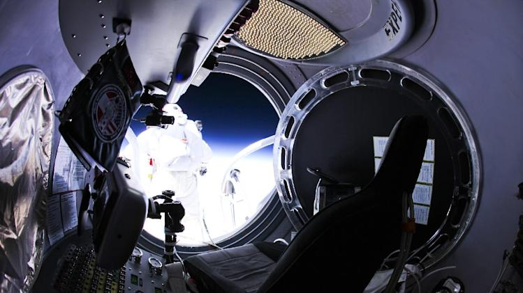 This photo provided by Red Bull Stratos shows pilot Felix Baumgartner of Austria as he jumps out of the capsule during the final manned flight for Red Bull Stratos on Sunday, Oct. 14, 2012. In a giant leap from more than 24 miles up, Baumgartner shattered the sound barrier Sunday while making the highest jump ever — a tumbling, death-defying plunge from a balloon to a safe landing in the New Mexico desert. (AP Photo/Red Bull Stratos, Jay Nemeth)