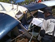 Indonesian search and rescue members examine the wreckage of Susi Air's plane, Pilantus Porter PKVVQ, in Tabang, Balikpapan in East Kaimantan. A South African pilot and his Australian passenger were killed when the plane crashed, in the airline's third fatal accident in a year